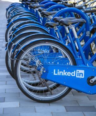 bikes in a rack with LinkedIn logo