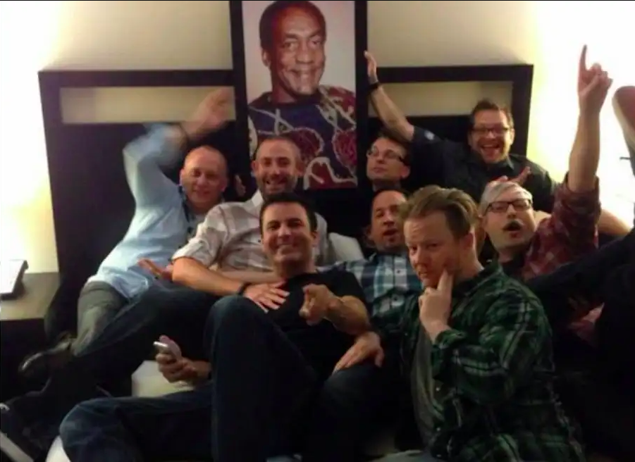 Activision Blizzard executives gather in front of a portrait of Bill Cosby in the infamous 'Cosby suite'