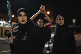 Three Muslim women ready to defend themselves with a baseball bat