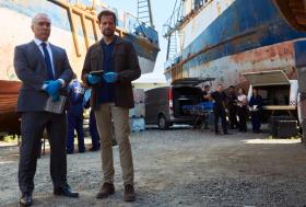 Two investigators, big ships, watching cops