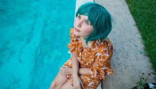 pensive girl by pool