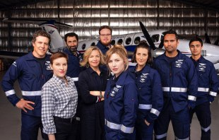 Actors by plane, all in blue