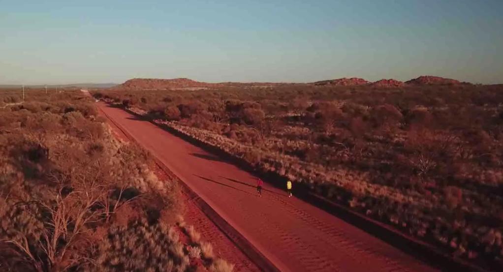 Red desert, men running