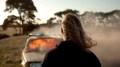 Boy watches burning car